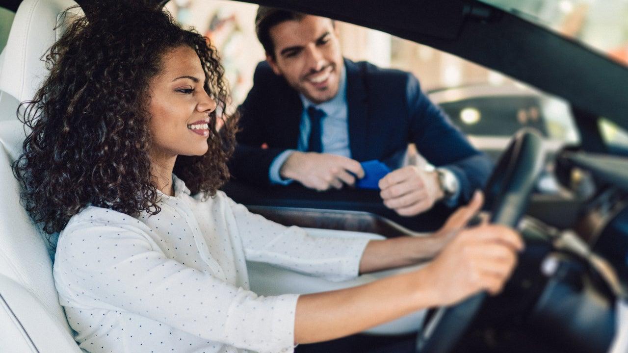 A woman buys a car