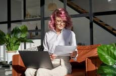 Young hipster woman reading paperwork