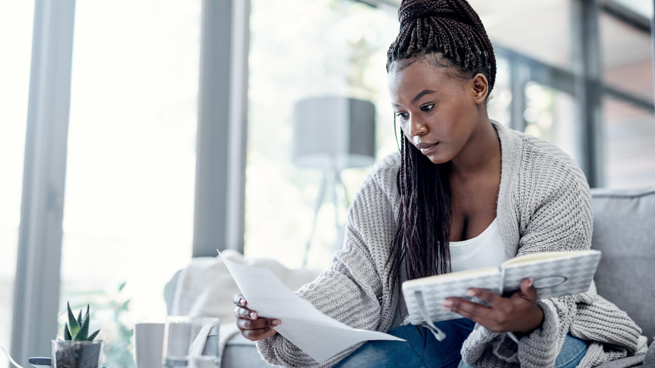 Woman reading bank statements