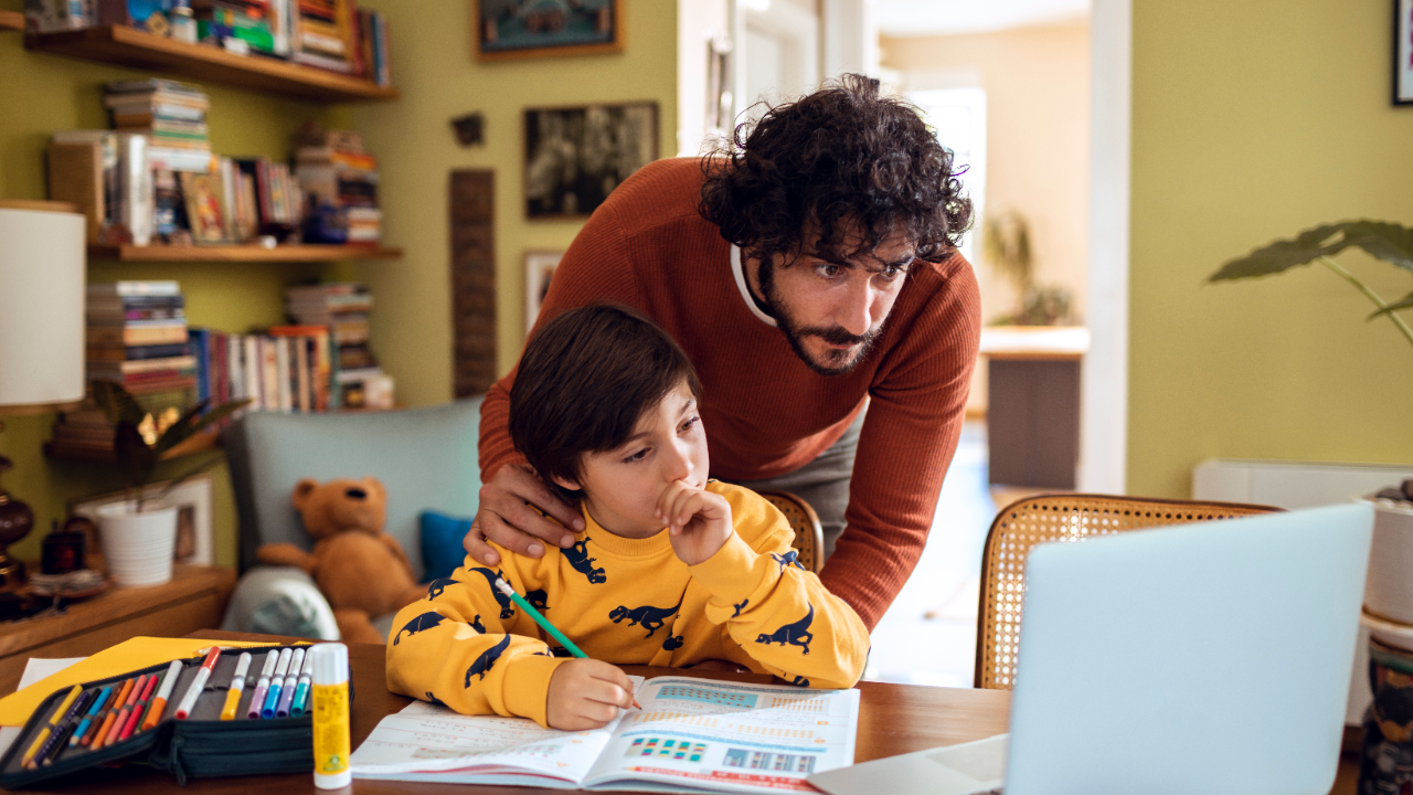 Father helps son with his homework