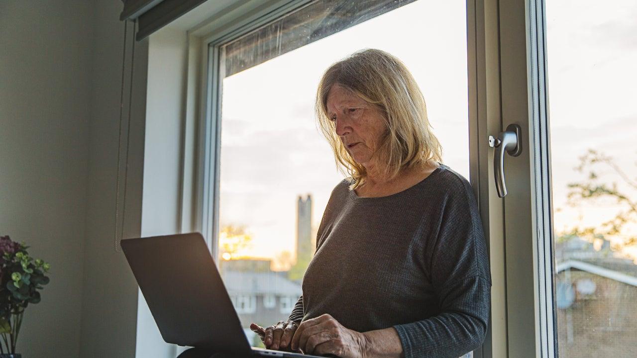 Senior lady on laptop - negative emotion