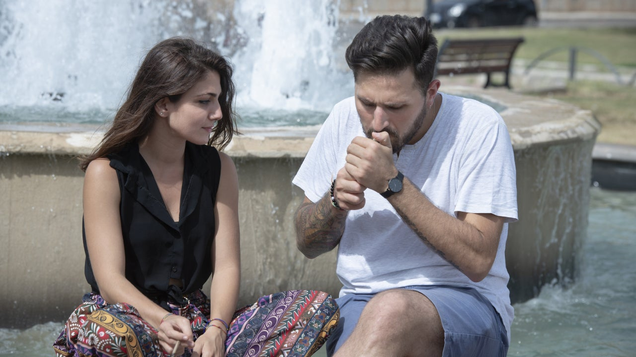 Two friends smoking in the public park