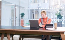 Woman in laptop in corporate building