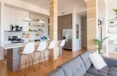 A condo kitchen with a modern open-floor plan