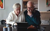 Senior couple works on iPad
