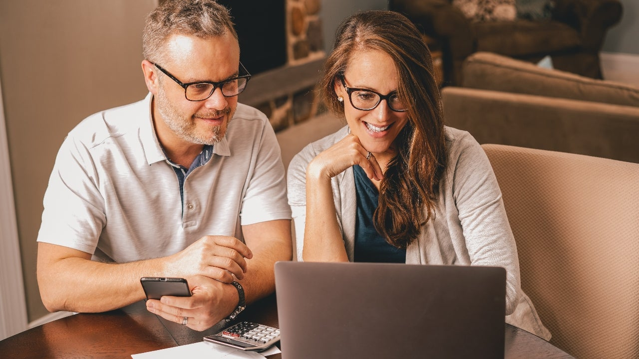 Homeowners review refinance offers online.