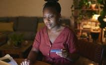 Woman paying credit card bill