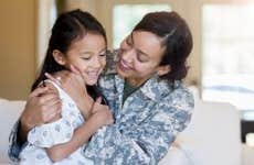 Woman soldier with her daughter