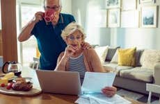 Senior couple reviewing credit card statements