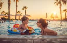 Mother with child in swimming pool at resort