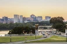 Rock Creek and Potomac Parkway road by Potomac river with view of Rossyln district in Virginia, USA at sunset