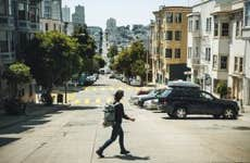 A woman crossing the street in San Francisco