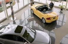 Man Looking at an Audi Convertible