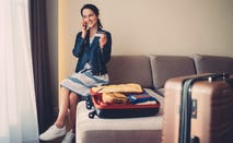 Woman with luggage in hotel