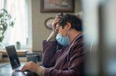 Masked man with laptop during a virus epidemic