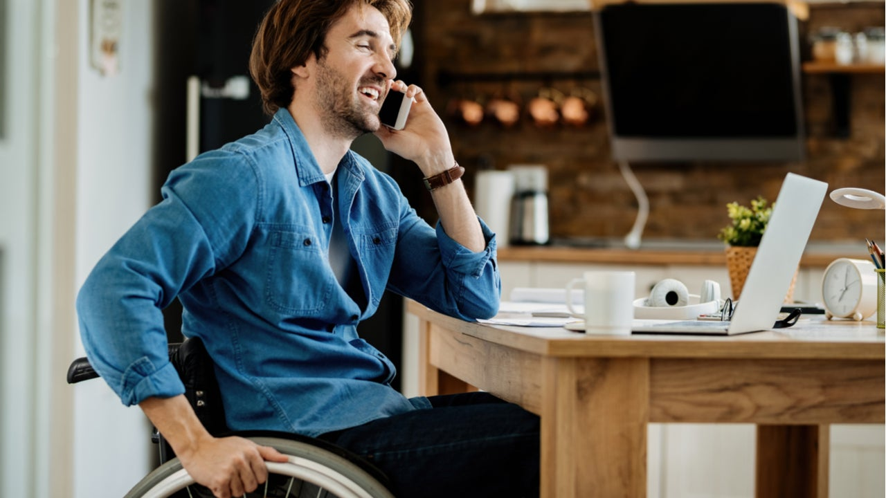 Young man working from home in a wheelchair