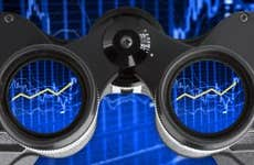Binoculars showing an investment performance graph in the lenses