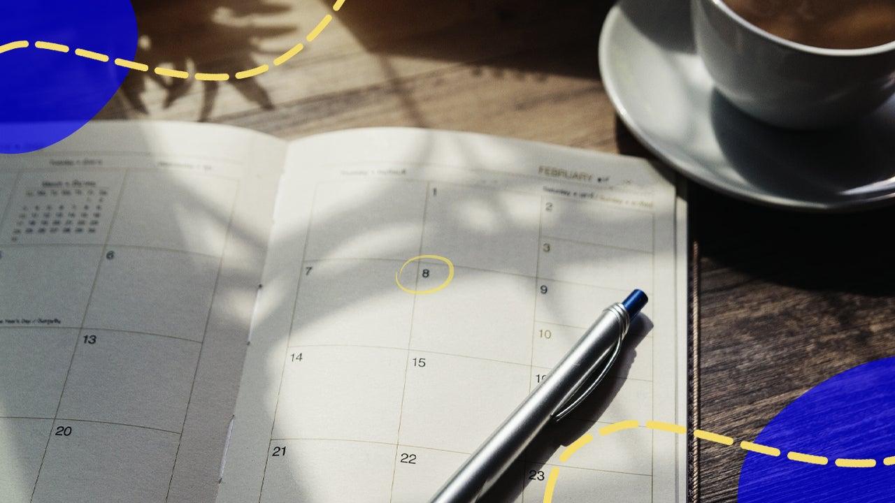 Pen sitting on top of a planner calendar