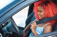 Portrait of afro woman preparing to drive