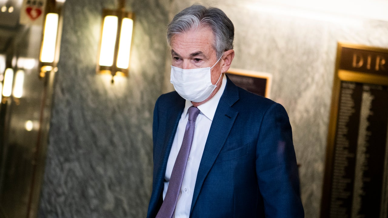 Fed chair Jerome Powell with a facemask on