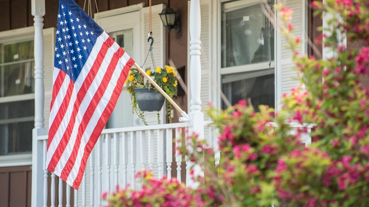 A closeup of the U.S. flag on a single-family home