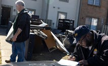 Deputy Service Bailiff Michael Taylor signs a writ of eviction in the unincorporated community of Galloway on March 3, 2021 west of Columbus, Ohio. Taylor says that he usually waits days past the deadline to clear out properties so there is not a confrontation.
