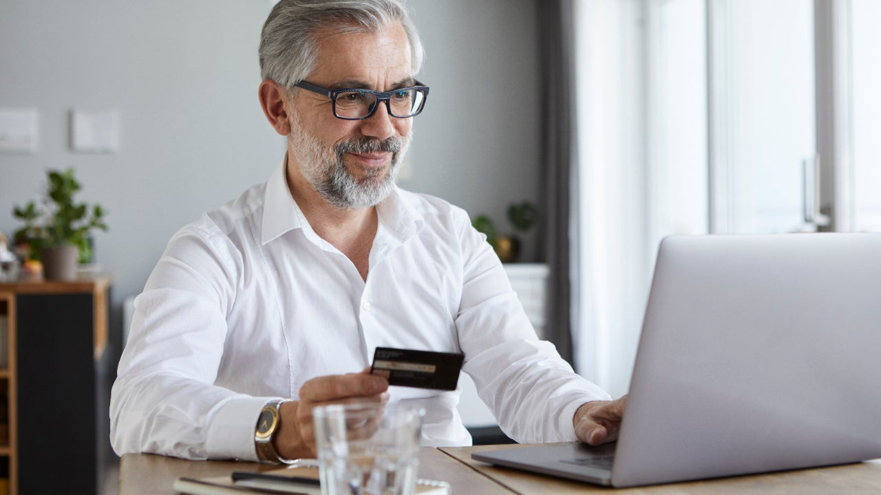 Business person holding credit card