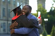 Father and son embrace at college graduation