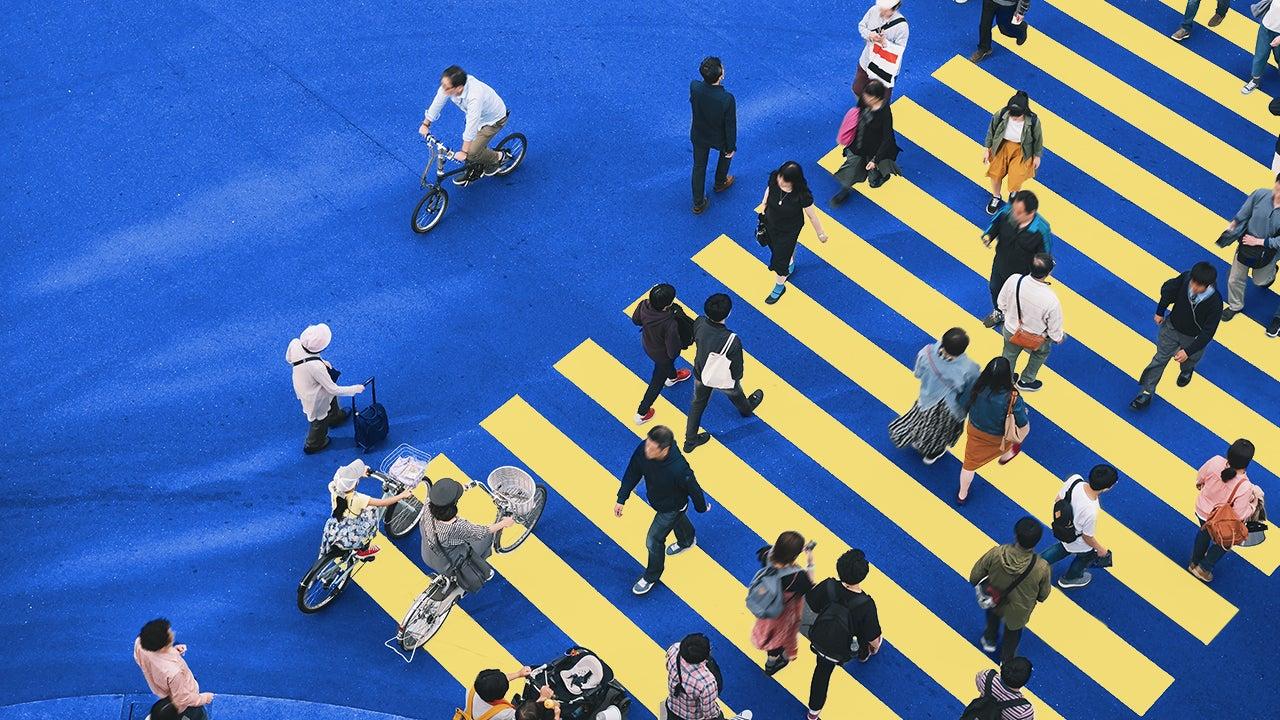 People walking across a cross-walk