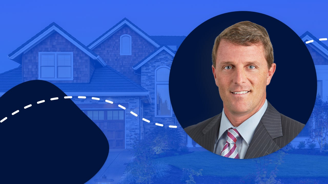 Greg McBride headshot with a home in the background
