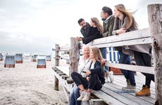 family and friends on the boardwalk on the beach