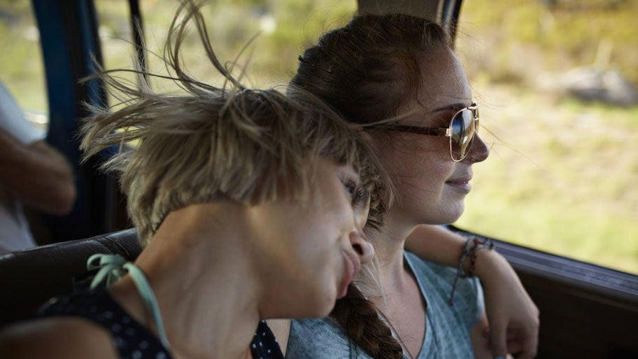 Two girls sit together enjoying a nice drive in the Sunshine State.