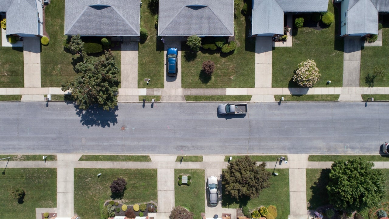 An aerial view of a neighborhood of single-family homes