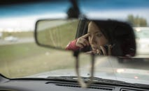 Woman using her cell phone while driving