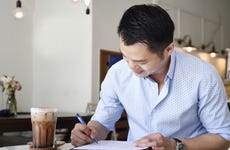 Business man reviewing paperwork in a cafe