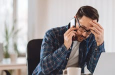 Worried businessman talking on phone