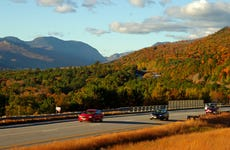 Interstate 93 South in New Hampshire just South of Franconia Notch with traffic on highway