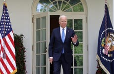 President Biden walks into the Rose Garden