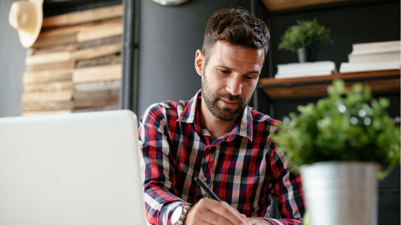 Man works on paperwork at a desk