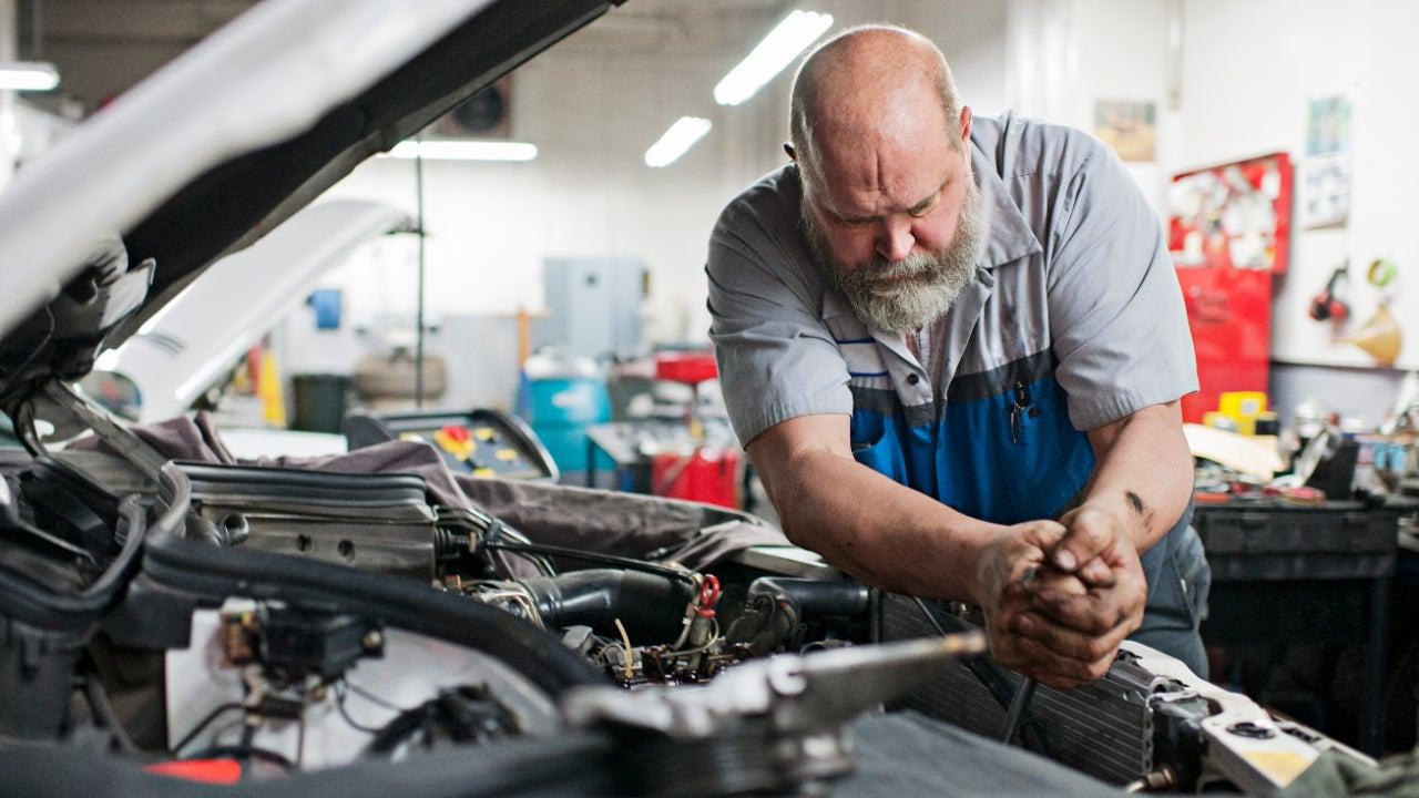 Mechanic uses force to unlock bolt