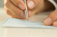 Person writing a check