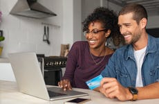 Couple looking at credit card offers on CardMatch