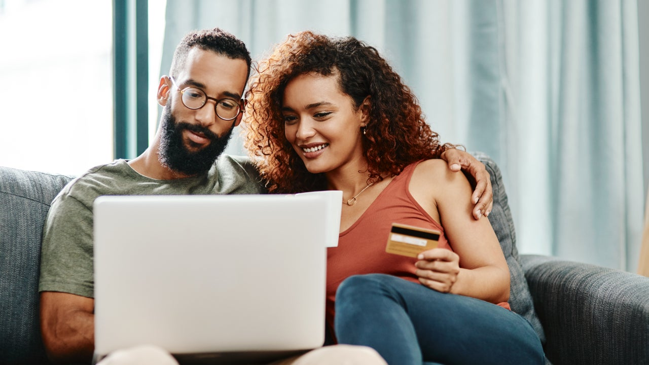 Couple looking at credit card offers online
