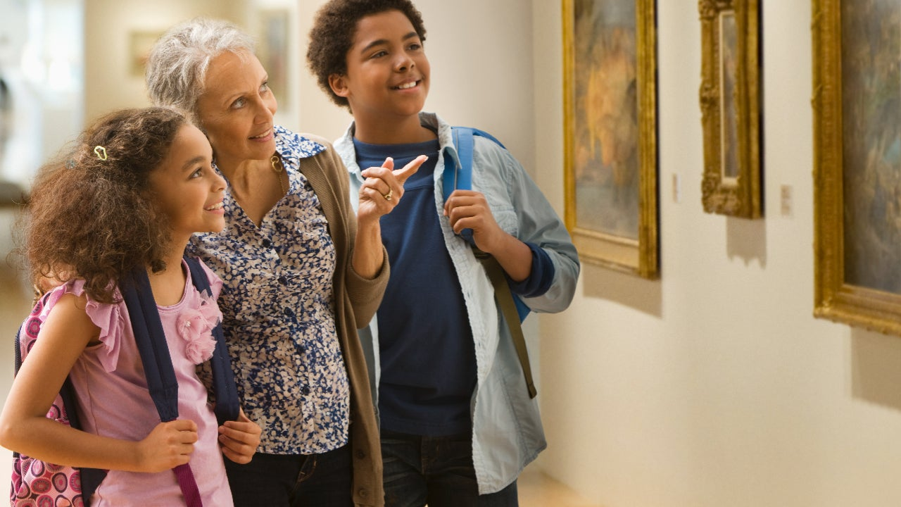 Family looking at art at museum