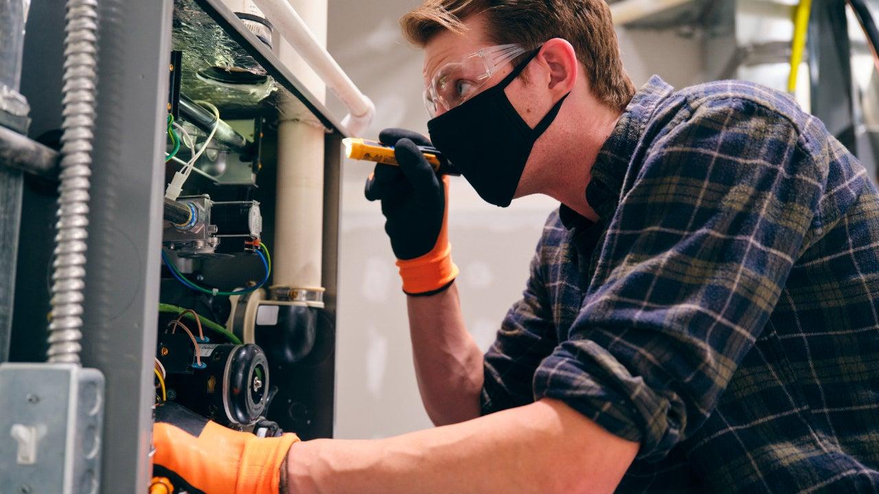 Home repair technician wearing a face mask