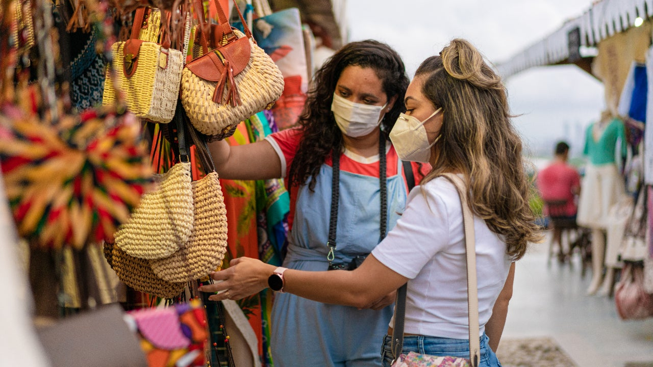 Two young women at open air market