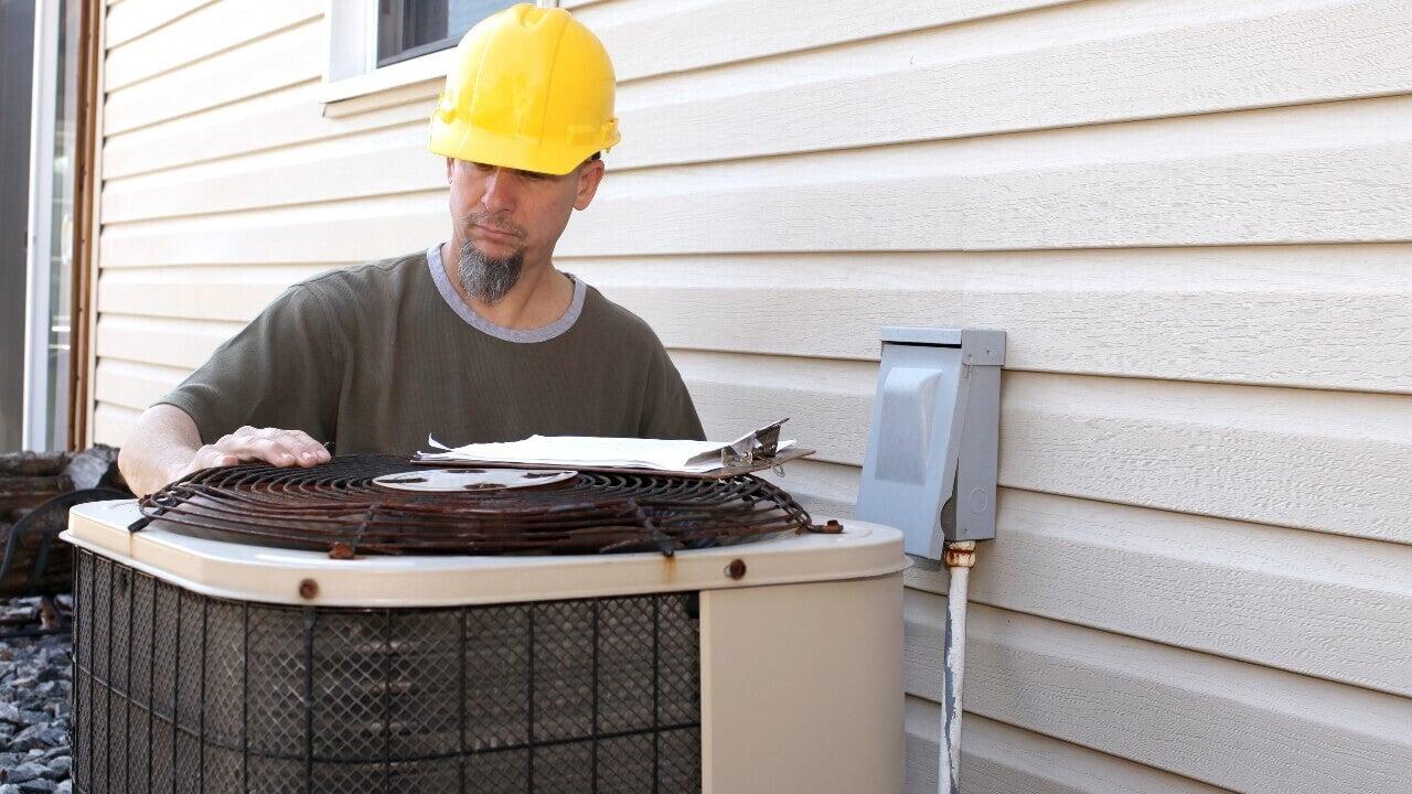 A A/C technician tests a new install