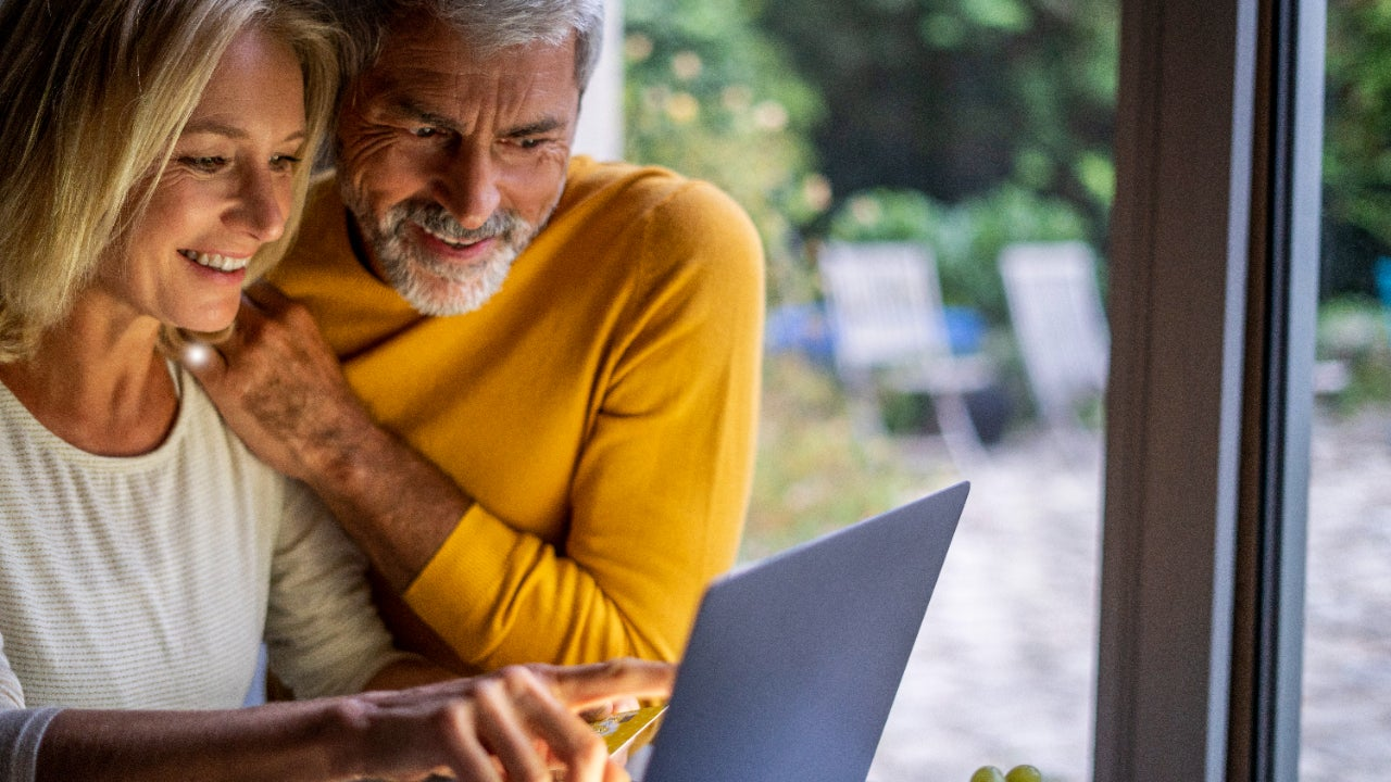 Older couple in front of laptop