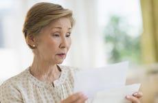 USA, New Jersey, Jersey City, Senior woman reading letter