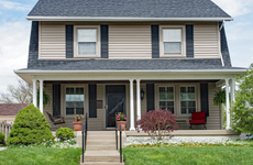 A two-story home with porch